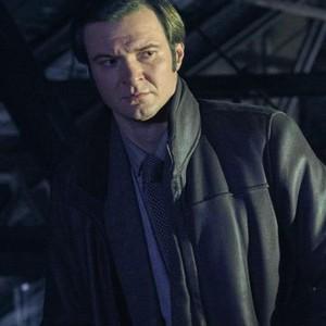 Costa Ronin as Oleg Burov