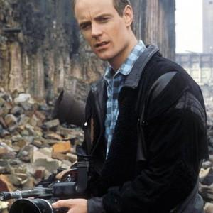 Matt Frewer as Edison Carter