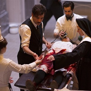 Eve Hewson, Clive Owen, Michael Angarano, and Cara Seymour in season one of <em>The Knick</em>.