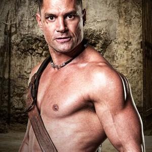 Manu Bennett as Crixus