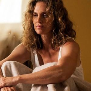 Amy Brenneman as Laurie