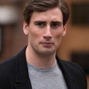 Edward Holcroft as Alex