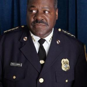 Frankie R. Faison as Comm. Ervin H. Burrell