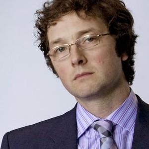 Chris Addison as Oliver Reeder