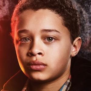 Elijah Jacob as TJ Moran
