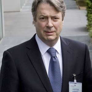 Roger Allam as Peter Mannion