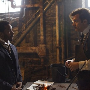 Andre Holland as Dr. Algernon Edwards and Clive Owen as Dr. John W. Thackery.