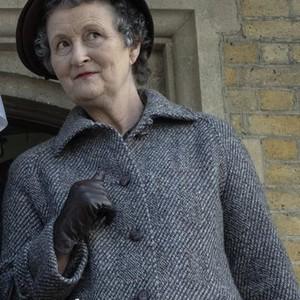 Georgie Glen as Miss Higgins