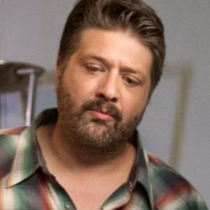 Lance Barber as Paulie G.