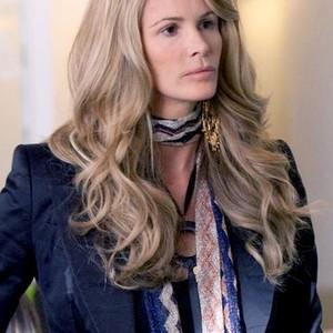 Elle Macpherson as Claudia Foster