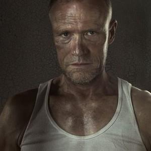 Michael Rooker as Merle Dixon