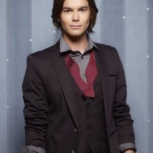 Tyler Blackburn as Caleb Rivers