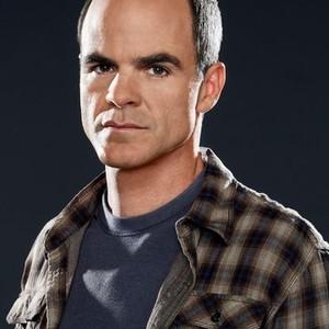 "Michael Kelly as John ""Prophet"" Sims"