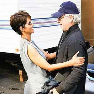 """""""Pilot -- Re-entry"""" -- EXTANT: A behind-the-scenes photo from the set of EXTANT of Academy Award winner Halle Berry greeting Academy Award winner and Executive Producer Steven Spielberg. CBS's new summer series is a mystery thriller starring Berry as Molly Woods, a female astronaut trying to reconnect with her family after returning from a year in outer space. Her mystifying experiences in space lead to events that will ultimately change the course of human history. EXTANT premieres Wednesday, J"""
