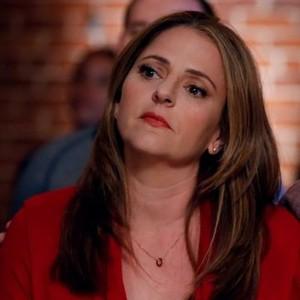 Annie Mumolo as Laurie