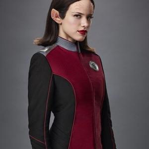 Halston Sage as Chief Security Officer Alara Kitan
