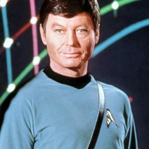 DeForest Kelley as Dr. Leonard McCoy